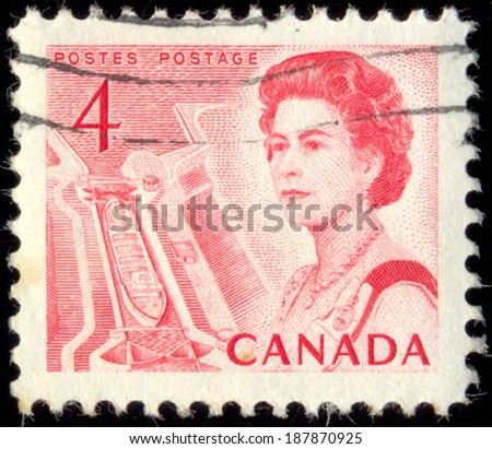 CANADA - CIRCA 1967: A stamp printed in Canada, shows Queen Elizabeth II and Ship in lock (Central Canada), circa 1967