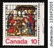 CANADA - CIRCA 1976: A stamp printed in Canada, shows Stained-glass windows, Nativity, St. Michaels, Toronto, circa 1976 - stock photo