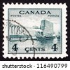 CANADA - CIRCA 1942 a stamp printed in the Canada shows Grain Elevators in Harbor, circa 1942 - stock photo