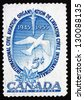 CANADA - CIRCA 1955: a stamp printed in the Canada shows Torch, Dove and Maple Leaves, 10th Anniversary of ICAO, circa 1955 - stock photo