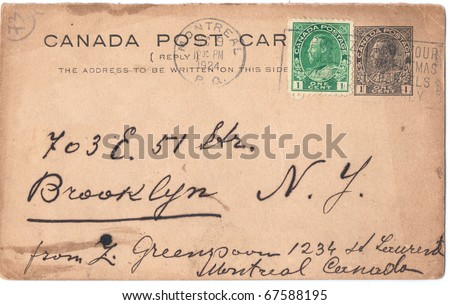 CANADA - CIRCA 1924: An old used postcard and postage stamps sent from Montreal to New York (USA). Rich stain and paper details. Can be used for background, series, circa 1924 - stock photo