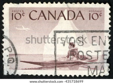 CANADA - CIRCA 1955: post stamp printed in Canada shows eskimo sitting in kayak; plane in sky; Scott 351 A148 10c brown; circa 1955