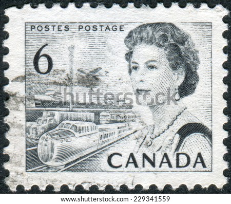 CANADA - CIRCA 1970: Postage stamp printed in Canada, shows Transportation Means, a portrait of Queen Elizabeth II, circa 1970 - stock photo