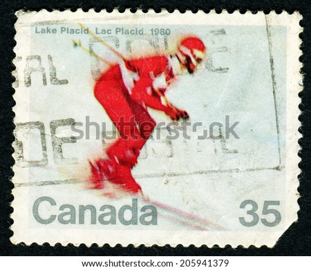 CANADA - CIRCA 1980: Postage stamp printed in Canada with image of a downhill skier to commemorate the 1980 Winter Olympic Games in Lake Placid, USA. - stock photo