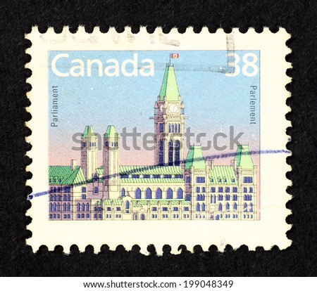 CANADA - CIRCA 1988: Postage stamp printed in Canada with image of the Parliament of Canada on Parliament Hill in Ottawa. - stock photo