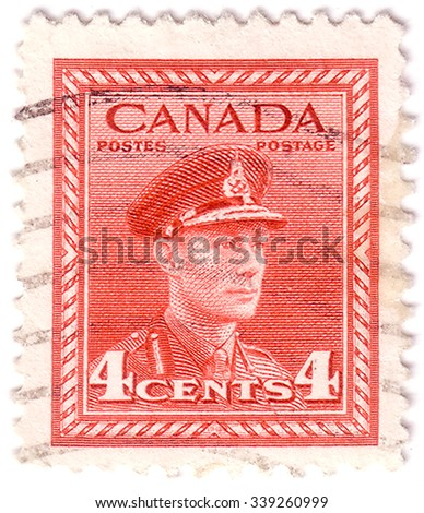 CANADA - CIRCA 1943: Red color postage stamp printed in Canada with portrait image of King George VI in military uniform. circa 1943 - stock photo