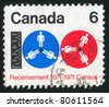 CANADA - CIRCA 1971: stamp printed by Canada, shows Computer Tape and Reels, circa 1971 - stock photo