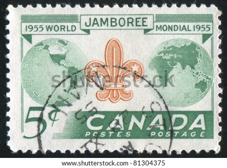 CANADA - CIRCA 1955: stamp printed by Canada, shows Globe and Scout Emblem, circa 1955 - stock photo