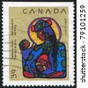 CANADA - CIRCA 1990: stamp printed by Canada, shows Virgin Mary with Christ Child, circa 1990 - stock photo