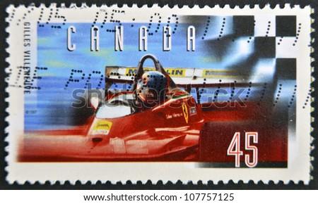 CANADA - CIRCA 1997: stamp printed in Canada, shows Gilles Villeneuve, Formula One Race Car Driver, circa 1997 - stock photo