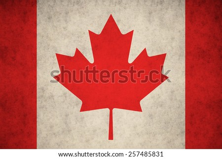 Canada flag on concrete textured background - stock photo