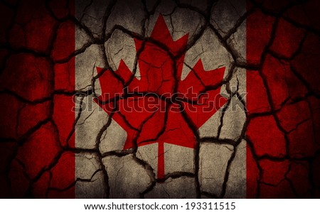 Canada flag painted on cracked soil - stock photo