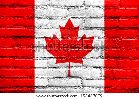Canada Flag painted on old brick wall - stock photo