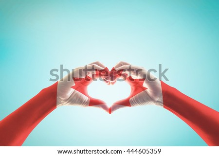 Canada flag pattern on people hands in heart shape isolated on blue vintage sky background: National Canadian red maple leaf symbol for Canada labour May day, veterans, commonwealth holiday concept - stock photo