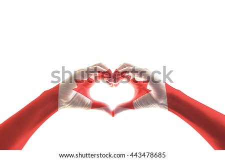 Canada flag pattern on people hands in heart shaped isolated on white background, clipping path: National Canadian red maple leaf symbol for Canada labour day, veterans, commonwealth holiday concept - stock photo