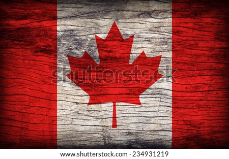 Canada flag pattern on wooden board texture ,retro vintage style - stock photo