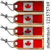 Canada Flags Set of Grunge Wooden Tags / Four grunge wooden tags with Canada flags, steel cable and metal rivets - stock photo
