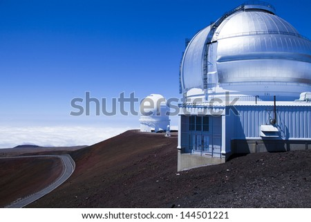 Canada-France-Hawaii Telescope and the  Gemini Telescope on top of Mauna Kea on the big Island of Hawaii - stock photo