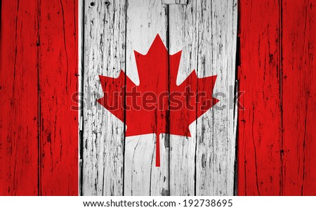 Canada grunge wood background with Canadian flag painted on aged wooden wall. - stock photo