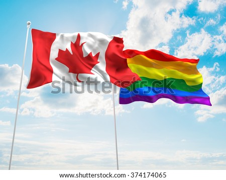 Canada & LGBT Community Pride Flags are waving in the sky - stock photo