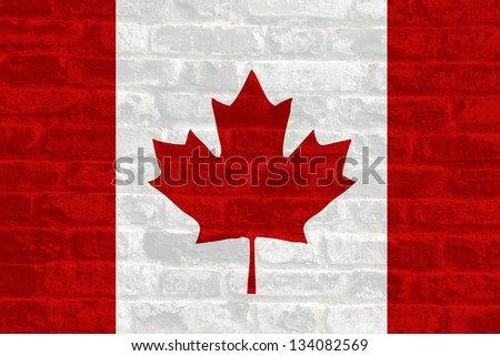Canada national flag on stone wall background - stock photo