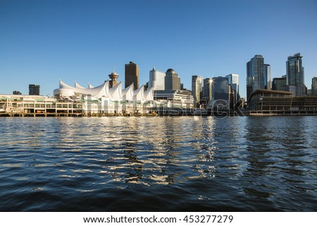 Canada Place in Downtown Vancouver, British Columbia, Canada, viewed from water during a sunset.