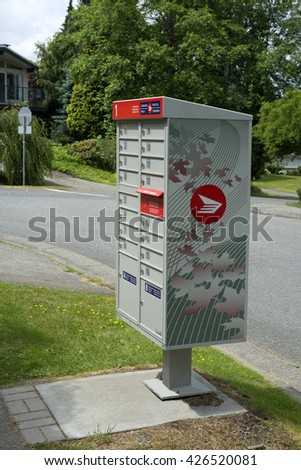 CANADA POST - MAY 25, 2016: New line of Canada Post community mailboxes were placed in distanced locations. Every business day, Canada Post provides service to 15 mill. places with 45 million items.   - stock photo