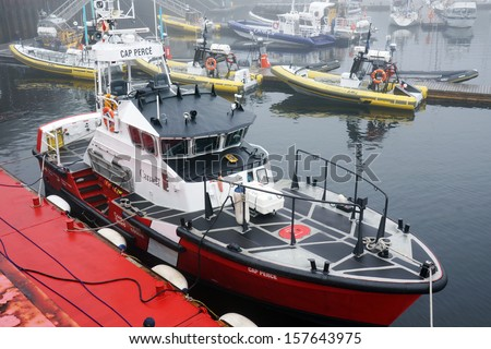 CANADA, QUEBEC, TADOUSSAC- AUGUST 8: Canadian coast guard vessel docked in Tadoussac, Quebec, Canada on August 8, 2013. The Canadian coast guard is responsible for 8 million km2 of water. - stock photo