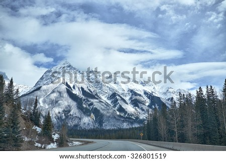 Canada Rocky Mountains from the Trans-Canada Highway in winter - stock photo