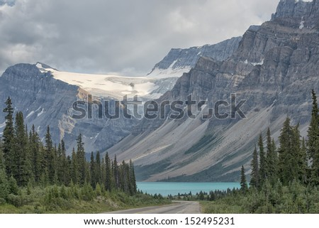 Canada Rocky Mountains Panorama on cloudy sky - stock photo