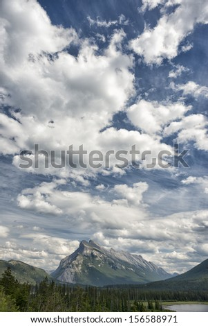 Canada Rocky Mountains Panorama on cloudy sky