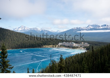 Canada, Rocky Mountains: view point above lake Louise with view at the frozen lake and also the hotel Fairmont Chateau - stock photo