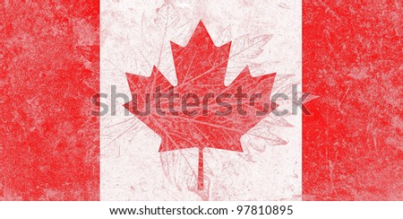 Canada state flag on grunge pattern of leaf - stock photo