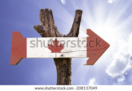 Canada wooden sign on a beautiful day - stock photo