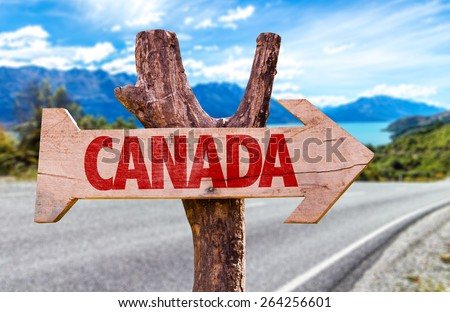 Canada wooden sign with a road background - stock photo
