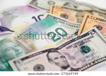 Canadian and US Dollars - stock photo