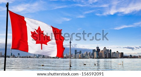 Canadian flag and Toronto city skyline - stock photo