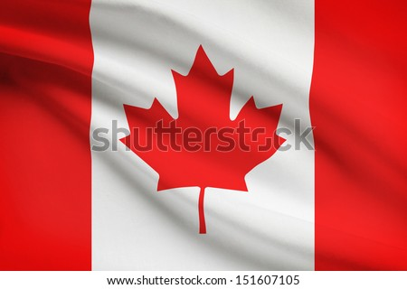 Canadian flag blowing in the wind. Part of a series. - stock photo