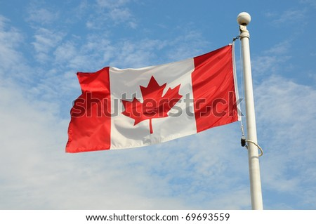 Canadian flag flying in the wind - stock photo