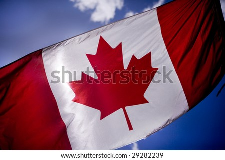 Canadian flag is tattered as Canadian troops - stock photo