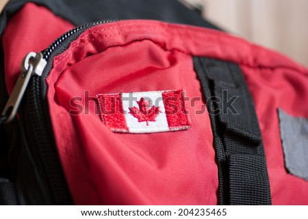 Canadian flag on a backpack - stock photo