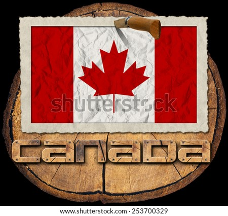 Canadian Flag on Section of Tree Trunk. Flag of Canada in a old photo frame with wooden text canada on a section of tree trunk isolated on black background - stock photo