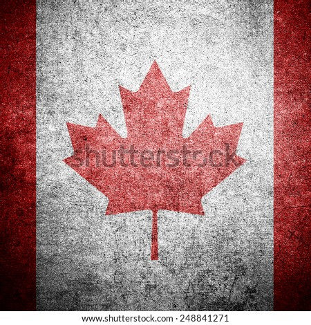 Canadian flag on the grunge concrete wall - stock photo