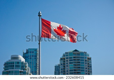 Canadian flag on the Vancouver skyscrapers background - stock photo
