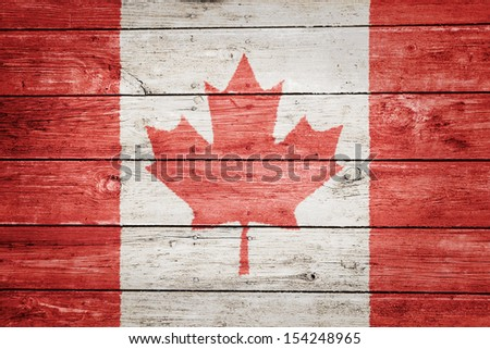 canadian flag on wood texture background - stock photo