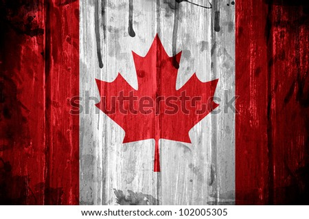 Canadian flag overlaid with grunge texture - stock photo