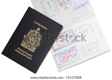 Canadian passports with entrance stamps on white