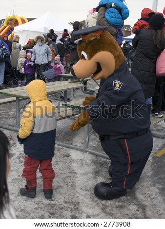 canadian policeman talking to a boy - stock photo