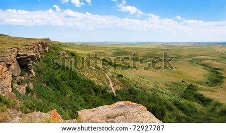 Canadian Prairie at Head-Smashed-In Buffalo Jump world heritage site in Southern Alberta, Canada - stock photo