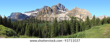 Canadian Rockies, lake and wood in National park (Canada) - stock photo